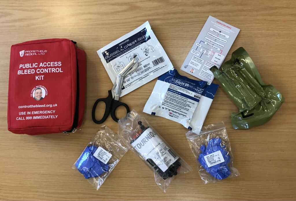 Red bleed control kit with contents including scissors and tourniquets